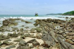 Landscape in Koh Samet. Wave crashing the rocks, Boat wobbling in the sea, at Koh Samet in Rayong Province, Thailand Royalty Free Stock Photo