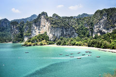 Landscape of Krabi beach, with rocks and boats, Thailand Stock Photo