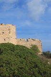 Landscape with Kritinia Castle. Stone wall masonry of the fortress of the Maltese period near Kritinia on a sunny day. Rhodes, Greece Royalty Free Stock Images