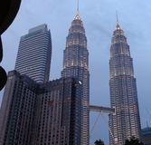 Landscape. KUALA-LUMPUR - Dec 10 2013: Petronas Twin towers on Dec 10 2013 in Kuala Lumpur, Malaysia. Petronas towers were tallest in the world from 1998 to 2004 Stock Images