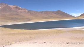 Landscape of lagoon, mountains and salt flats in Atacama desert, Chile