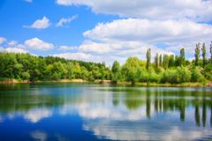 Landscape with a lake. River landscape with sky reflection in water Royalty Free Stock Photo