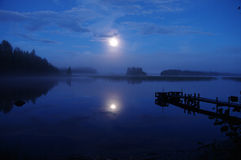 Landscape on the lake. In moonlight stock images