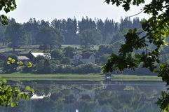 Landscape by the lake. A picture of a swedish landscape by the lake with reflexion Royalty Free Stock Photography