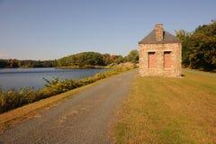 Landscape at lake. Stone small house at lake Stock Photos