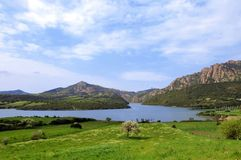 Landscape with lake. Sardinia view of landscape with lake and mountains stock photography