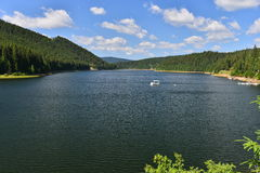 Landscape with lake, boat and forest at Fantanele resort. Stock Images