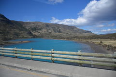 Landscape of lake,bridge and mountains in Patagonia Chile Royalty Free Stock Photos