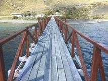 Landscape of lake,bridge and mountains in Patagonia Chile Royalty Free Stock Photo