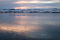 Landscape with lake covered with thin layer of ice Stock Photography