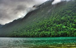 Landscape with lake and forest. In mountains in a rainy day Royalty Free Stock Images