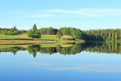 Landscape with lake, forest and fields Stock Photo