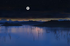 Landscape Lake with full moon Stock Photo