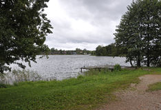 Landscape of Lake Galve in Trakai in a rainy day Royalty Free Stock Photography