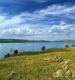 Landscape with lake between hills Royalty Free Stock Photo