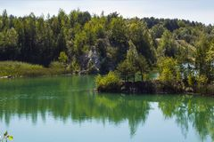 Landscape with lake, Kostopil granite quarry, Ukraine. Lake in Kostopil granite quarry, Rivne Oblast, Ukraine. Summer landscape with blue lake Royalty Free Stock Photo