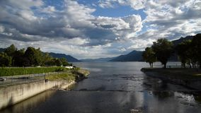 Landscape of lake Maggiore with cloudy blue sky at sunset. stock footage