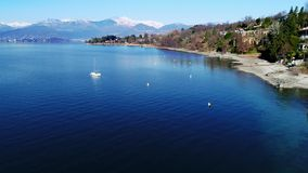 Landscape of Lake Maggiore and Swiss alps, aerial view from Reno beach in province of Varese. stock video footage