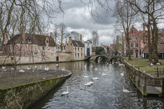 Landscape at Lake Minnewater in Bruges, Belgium. Swan Lake near Beguinage, one of the main symbols of contemporary Bruges Stock Photo
