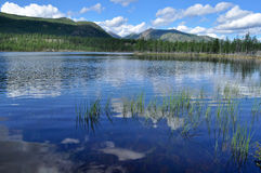 Landscape with a lake and mountains along the banks. Eastern Yakutia. Summer landscape with a lake and mountains along the banks Stock Images