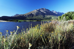 Landscape with lake and mountains and blue skies Stock Image
