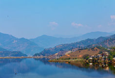 Landscape with lake and mountains stock photos