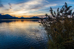 Landscape with lake and mountains during sunset Stock Photo