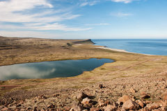 Landscape with lake and ocean coastline, Westfjords, Iceland Stock Photos