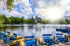 Landscape lake with pedal boats Royalty Free Stock Photography