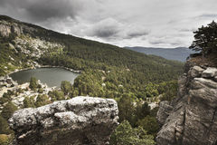 Landscape with lake and pine forest in Spain. Laguna Negra Royalty Free Stock Photo
