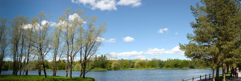 Landscape with a lake, poplars and walkways Stock Photo