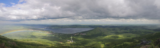 Landscape with lake and rainbow 1. Landscape with lake Bannoe Russia and rainbow Stock Photography