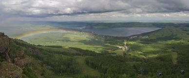 Landscape with lake and rainbow. Landscape with lake Bannoe Russia and rainbow Stock Photo