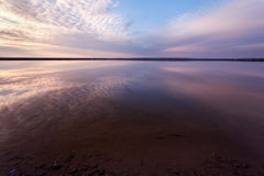 Landscape with lake reflection clouds. Beautiful summer sunset Royalty Free Stock Photos