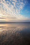 Landscape with lake reflection clouds. Beautiful summer sunset Royalty Free Stock Image