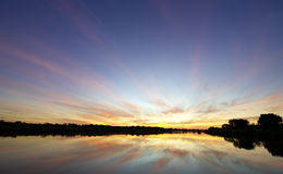 Landscape of a lake at sunset Royalty Free Stock Photo