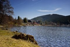 Landscape of lake Titisee and town of Titisee-Neustadt stock image