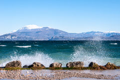 Landscape of a lake with waves and squirts on a windy day Stock Photography