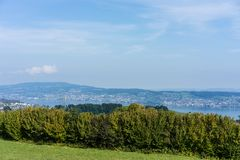Landscape of lake zurich in summer with tree line hiking trail switzerland tourism travel destination nature panorama Stock Photo
