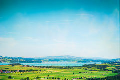 Landscape with lakes, fields and blue sky in germany. Outdoor stock photo