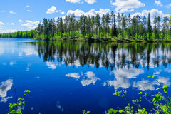 Landscape of lakes and reflections in Lapland. Landscape of lakes and reflections near Taipaleenoja, Posio, Lapland, Finland royalty free stock image
