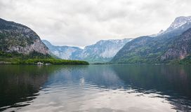 Landscape. Lakeside and snowy mountains at the cloudy day Royalty Free Stock Images