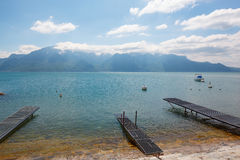 Landscape. Lakeside and snowy mountains at the sunny day Stock Photo