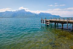 Landscape. Lakeside and snowy mountains at the sunny day Stock Photography
