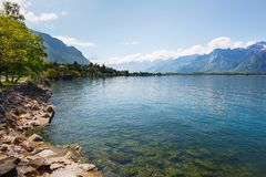 Landscape. Lakeside and snowy mountains at the sunny day Royalty Free Stock Images