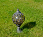 The landscape lamp costs on a green grass.  Royalty Free Stock Photos