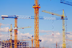 Landscape of large building with tower cranes Royalty Free Stock Images