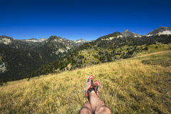 Landscape and legs during mountain hiking at Pyrenean mountain Stock Photography