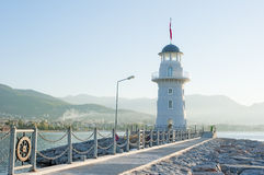 Landscape with a lighthouse. In the harbor town of Alanya at dawn Stock Photo