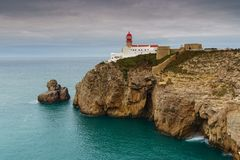 Landscape of the lighthouse and cliffs at Cape St. Vincent at sunset. Algarve amazing seascape.  Continental Europe`s most South-. Western point, Sagres royalty free stock image